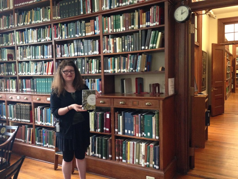 Larissa Glasser, library assistant at the horticultural library of the Arnold Arboretum at Harvard University about to tuck Witness Tree into the permanent collection.